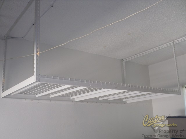 Garage Storage Can Be Done With Overhead Hanging Shelves