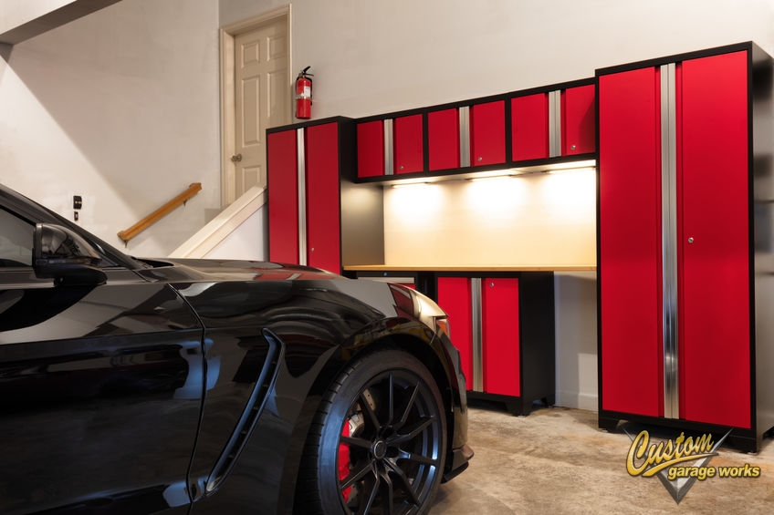 The Interior of a Garage with Red Garage Storage Cabinets.